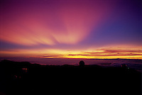 Crepuscular rays seen in the atmosphere above Mauna Kea.  This unusually colorful display is caused by distant clouds casting shadows on dust in the upper atmopshere.  The dust was emitted by an eruption of Mount Pinatubo in the Philippines.