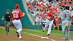 2 September 2012: Washington Nationals' first baseman Chad Tracy tosses to pitcher Ryan Mattheus to get Carlos Beltran out at first during a game against the St. Louis Cardinals at Nationals Park in Washington, DC. The Nationals edged out the visiting Cardinals 4-3, capping their 4-game series with three wins. Mandatory Credit: Ed Wolfstein Photo