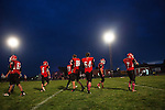Players for the Hoxie High School Indians take the field during their homecoming game in Hoxie, Kan. on Friday, Oct. 12, 2012. Parents and community members say that many graduating seniors are opting to either stay home after graduation or return home to work on their family farms after college because of a healthy local economy job opportunities in the agricultural sector. As historically dry conditions continue, farmers from South Dakota to the Texas panhandle rely on the Ogallala Aquifer, the largest underground aquifer in the United States, to irrigate crops. After decades of use, the falling water level ? accelerated by historic drought conditions over the last two years ? is putting pressure on farmers to ease usage or risk becoming the last generation to grow crops on the land. Farmers like Mitchell Baalman and Brett Oelke (both not pictured) are part of a farming community in in Sheridan County, Kansas, an agricultural hub in western Kansas, who have agreed to cut back on water use for crop irrigation so that their children and future generations can continue to farm and sustain themselves on the High Plains.