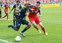 15 September 2012: Philadelphia Union midfielder Amobi Okugo #14 and Toronto FC forward Eric Hassli #29 in action during an MLS game between the Philadelphia Union and Toronto FC at BMO Field in Toronto, Ontario Canada. .