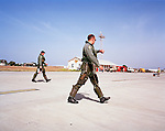Pilots of the 'Red Arrows', Britain's Royal Air Force aerobatic team pace out to aircraft before Cyprus training flight.