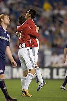 Chivas USA midfielder Jesus Padilla (10) celebrates his second goal of the night with Chivas USA midfielder Sacha Kljestan (16). Chivas USA defeated the New England Revolution, 4-0, at Gillette Stadium on May 5, 2010.
