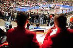 "Wundamike, right, and Wesley Page, known as the ""redcoats"" call the bout from the announcers stand during a bout between Hellcats and Putas del Fuego at the Palmer Events Center in Austin, Texas."