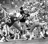 Raiders John Matuszak and Otis Sistrunk put rush on Green Bay Packers Lynn Dickey. (1976 photo by Ron Riesterer)