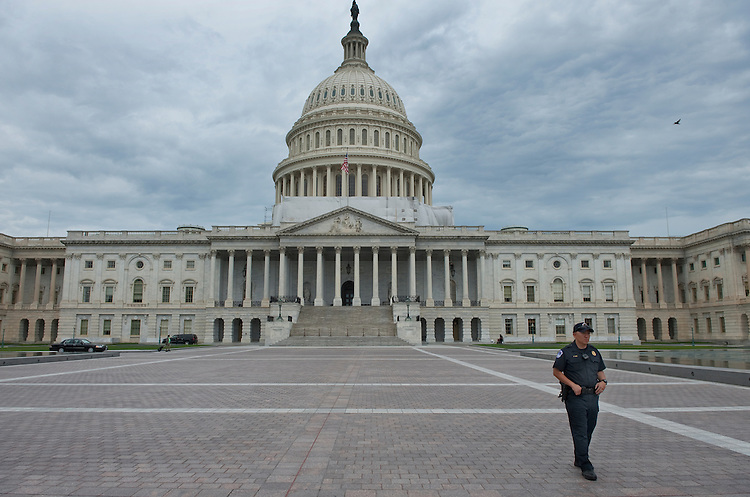 UNITED STATES - May 30: A U.S. Capitol Policeman keeps an eye on the East Front Plaza of the U.S. Capitol on a quiet day on Capitol Hill. May 30, 2012. (Photo By Douglas Graham/ CQ Roll Call)