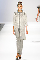 Andreea Diaconu walks the runway in a Luca Luca Fall 2011 outfit, designed by Raul Melgoza, during Mercedez-Benz Fashion Week, February 10, 2011