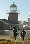 Surfers and Lighthouse in Santa Cruz