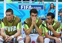 Fernando Torres, Cesc Fabregas and Pedro of Spain look dejected sat on the substitutes bench