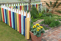 Learning at home: Crayon picket fence, pot of sunflowers