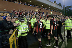 Supporters of Irish club Bohemians applaud their team off the field at Park Hall Stadium, Oswestry at the end of their team's Champions League 2nd qualifying round 2nd leg game away to The New Saints. Despite leading 1-0 from the first leg, the Dublin club went out following their 4-0 defeat by the Welsh champions. The match was the first-ever Champions League match in the UK played on an artificial pitch and was staged at the Welsh Premier League's ground which was located over the border in England.