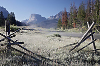 Squaretop Peak in the Wind River Mountains seen through a broken buck rail fence.