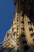 Archivolts and gargoyles in the distance, Portal of the echevins, Church of Notre Dame, 12th - 14th century, Mantes-la-Jolie, Yvelines, France Picture by Manuel Cohen