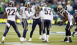 St. Louis Rams  defensive unit celebrates with cornerback Marcus Robinson (47) after he intercepted a pass thrown by Seattle Seahawks  quarterback Russell Wilson during the second quarter at CenturyLink Field in Seattle, Washington on December 28, 2014.  The Seahawks officially wrapped up the No. 1 seed in the NFC playoffs shortly after beating the Rams, 20-6. Despite the Cowboys and Packers also winning to finish 12-4, the Seahawks (12-4) won the multi-team tiebreaker and earned home-field advantage throughout the playoffs for the second consecutive season.  ©2014. Jim Bryant Photo. All Rights Reserved.