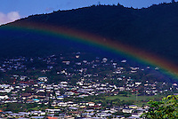 View of the houses in beautiful Manoa valley with rainbow