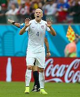 Michael Bradley of USA calms his players down