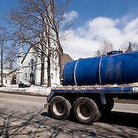 Trucks transport water through the town of Montrose, PA, USA, 26 March 2011. The region has experienced a surge in traffic with the boom of the natural gas industry, which uses large amounts of water in the hydraulic fracking process.