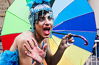 A man attends a parade while thousands of Argentinians take part in the XXII Gay Pride in Buenos Aires, Nov 9, 2013. VIEWpress/Juan Gabriel Lopera.