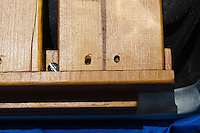 The wood screws used to hold the shelf to the risers are conveniently between the boards of the shelf, leaving it free of obstructions.
