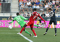 CHESTER, PA - AUGUST 12, 2012:  Chandler Hoffman (12) of the Philadelphia Union watches as the ball rebounds off  Jalil Anibaba (6)  of the Chicago Fire for an own goal for Philadelphia during an MLS match at PPL Park, in Chester, PA on August 12. Fire won 3-1.