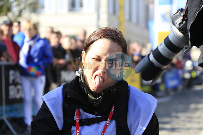 Photographer Iri Greco having a bad day at sign on for the 115th edition of the Paris-Roubaix 2017 race running 257km Compiegne to Roubaix, France. 9th April 2017.<br /> Picture: Eoin Clarke | Cyclefile<br /> <br /> <br /> All photos usage must carry mandatory copyright credit (&copy; Cyclefile | Eoin Clarke)