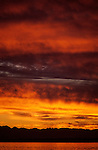 Dramatic sunset over Puget Sound and Olympic Mountain Range stratocumulus clouds Seattle Washington State USA..