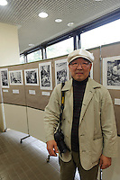 """Photographer Masatsugu Yokoyama at and exhibition of his historic prints of Yanaka, Yanaka, Tokyo, Japan, April 19, 2012. Yanaka is part of Tokyo's """"shitamachi"""" historic working class wards. Recently it has become popular with Japanese and foreign tourists for its many temples, shops, restaurants and relaxed atmosphere."""