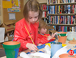 PLYMOUTH, CT - 12 MAY 2007 - 051207JW03.jpg-- Courtney Johnpiere age 6 and her sister Gabrielle Johnpiere age 3 paint some pots for a mothers day gift during the Terryville Public Library's Mother's Day craft event Saturday afternoon. Jonathan Wilcox Republican-American