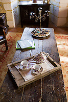 Tea tray with teapot and floral china cups in hotel, Hostellerie Les Griffons, Bourdeilles, North Dordogne, France