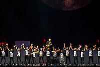 "A children's choir performs ""Another Brick in the Wall, Part 2"" with Roger Waters, a founding member and former bass player and lead vocalist of Pink Floyd, performs The Wall Live (an audio visual specatacle including 3D Animation and pyrotechnics) at the Pepsi Center, Denver, Colorado USA"