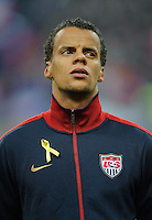 Timmy Chandler of team USA stands for the national anthem prior to the friendly match France against USA at the Stade de France in Paris, France on November 11th, 2011.