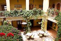 Guest looking out over the outdoor dining area in the Posada de las Minas, a luxury boutique hotel in Mineral de Pozos, Guanajuato, Mexico