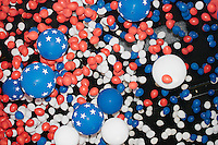 Balloons and confetti fall to the crowd after Democratic presidential nominee Hillary Clinton spoke on the final day of the Democratic National Convention at the Wells Fargo Arena in Philadelphia, Pennsylvania, on Thurs., July 28, 2016.