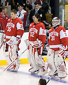 Grant Rollheiser (BU - 35), Adam Kraus (BU - 32), Kieran Millan (BU - 31) - The Boston College Eagles defeated the Boston University Terriers 3-2 (OT) in their Beanpot opener on Monday, February 7, 2011, at TD Garden in Boston, Massachusetts.