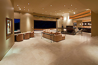 Huge living room is seen in ultra modern home at night