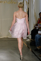 Model walks runway in a Dogwood dress by Carol Hannah Whitfield, for the Carol Hannah Spring Summer 2012 Bridal collection runway show.