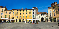 Buildings surrounding the Piazza dell'Anfiteatro inside the ancinet Roman ampitheatre of Lucca, Tunscany, Italy