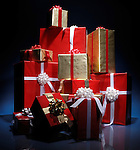 Huge pile of Christmas gift boxes illuminated in darkness isolated on blue black background