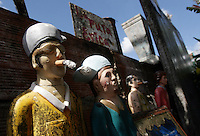 Figures of the Court of the Saint Tugs in Caracas cementery, where people makes them offerings in the way of cheap alcohol, cigars and marijuana.<br /> Pictures part of an  essay by Howard Yanes The Borders of Faith in Venezuela. Howard says :&quot;This are religions or beliefs from which no one speaks clearly but everydoby  knows they exist. Everybody pretends they are irrelevant, some of them even could laugh about this beliefs  but nobody would dare to remove those pieces of voodoo ceremony you can find at any cementery, or to close down the illegal shops selling animals for sacrifice.&quot;