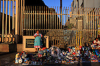 A vendor sells items at a stand at the Mexico-U.S. border in Tijuana, Mexico.