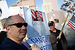 DENVER, CO - JANUARY 9: Second Amendment supporter Paul Padovano, left, of Centennial, Colorado gathered with others across the street from the Colorado State Capital in Denver, Co. Wednesday January 9, 2013 to voice their support for gun ownership. The issue should prove to be a contentious one for lawmakers in Colorado, being home to mass shootings at both Columbine High School and the Aurora movie theater shootings. (Photo by Marc Piscotty / © 2013)