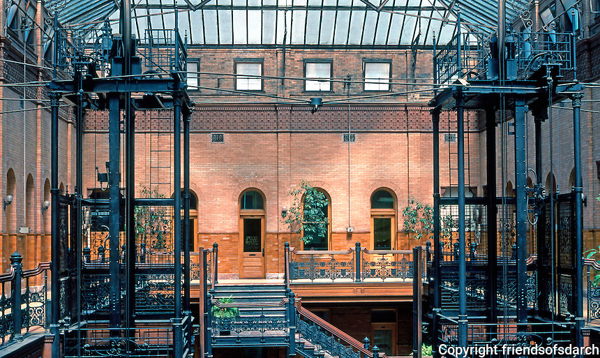 Los Angeles: Bradbury Building. Caged elevators. Note the natural light and walls of pale glazed brick. Photo '78.