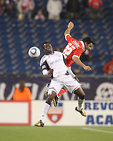 New England Revolution forward Kenny Mansally (7) and SL Benfica defender Luis Filipe (22) battle for head ball. SL Benfica  defeated New England Revolution, 4-0, at Gillette Stadium on May 19, 2010.