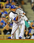 22 July 2011: Los Angeles Dodgers pitcher Hiroki Kuroda attempts a bunt against the Washington Nationals at Dodger Stadium in Los Angeles, California. The Nationals defeated the Dodgers 7-2 in their first meeting of the 2011 season. Mandatory Credit: Ed Wolfstein Photo