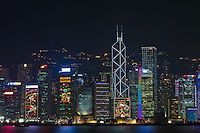 The skyscrapers along Hong Kong island's harbour waterfront at night, with fa&ccedil;ades covered with decorative lighting designs for Christmas