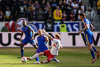 Dax McCarty (11) of the New York Red Bulls goes for a tackle on Nick LaBrocca (2) of the Colorado Rapids. The New York Red Bulls and the Colorado Rapids played to a 1-1 tie during a Major League Soccer (MLS) match at Red Bull Arena in Harrison, NJ, on March 15, 2014.
