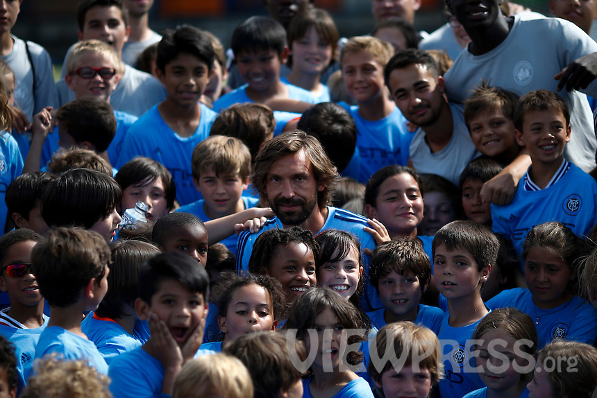 Andrea Pirlo (C ) poses for a picture with kids after a press conference with his new team New York City FC at Manhattan in New York. 07.23.2015.  Eduardo MunozAlvarez/VIEWpress.