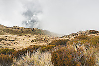 Swirling clouds in mountains near Mt. Brown Hut. Arahura River visible, West Coast, South Westland, New Zealand