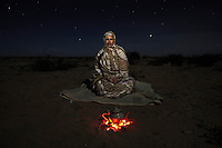 Djimi Elghalia, 48, vice president of the Saharawi Association of Victims of Grave Human Rights Violations Committed by the Moroccan State (ASVDH). Pictured near El Aaiun city, in Moroccan controlled Western Sahara (Saharawi Arab Democratic Republic): 'I was born in Agadir, Morocco, in 1961. A lot of Saharawis used to stay at our home and because of this my grandmother was arrested in 1984. She was sixty; we never saw her again. In 1986 I moved to El Aaiun for work after I graduated in agriculture. The next year I was arrested along with five hundred others for trying to organise a demonstration on independence before a big United Nations visit. They held eighty including nineteen women. They interrogated me and used physical and psychological torture. They would put chemicals in my hair which made me faint. I was electrocuted on the arms and back and was bitten by dogs. Later they would laugh and say that there are no dogs and I must be imagining things. As a defender of human rights we are all about a peaceful solution. Whether the Polisario want to go back to war is up to them but as a civil society we are calling for a peaceful solution and this will come from international pressure.'.