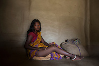 "India - Jharkhand - Dhab - ""That day I went to mine at 9, together with my parents. When I started digging, the walls were so soft that they collapsed upon me. I fainted immediately"" A beautiful mother of four kids, four months ago 25-year-old Sarita Devi fractured her right leg when the mine she was working subsized, completely burying her. Today, she still cannot walk properly, bend or crouch. Unable to help her family in the mine, she stays at home, looking after her sons and elder relatives. Although she doesn't like the idea of going back to the mine, Sarita will have to, once she will completely recover from the accident in one-year-time. The eldest of two brotherless sisters, it's Sarita who will have to look after her aging parents and find a way to repay the 100,000 rupees loan the family took to pay for her hospital expenses."