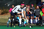 15 November 2014: Liberty's Sarah Gipe (left) and North Carolina's Abby Frey (25) (right). The University of North Carolina Tar Heels hosted the Liberty University Flames at Francis E. Henry Stadium in Chapel Hill, North Carolina in a 2014 NCAA Division I Field Hockey Tournament First Round game. UNC won the game 2-1.